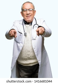 Handsome senior doctor man wearing medical coat Pointing to you and the camera with fingers, smiling positive and cheerful