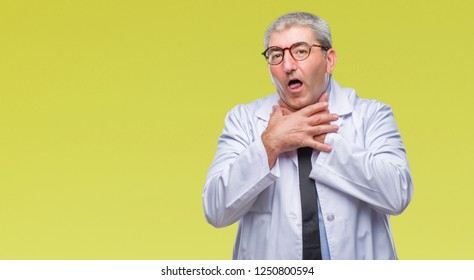 Handsome senior doctor, scientist professional man wearing white coat over isolated background shouting and suffocate because painful strangle. Health problem. Asphyxiate and suicide concept.