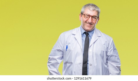 Handsome senior doctor, scientist professional man wearing white coat over isolated background winking looking at the camera with sexy expression, cheerful and happy face.