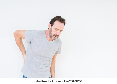 Handsome senior man over isolated background Suffering of backache, touching back with hand, muscular pain