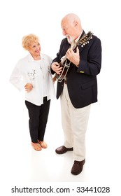 Handsome senior man serenading his beautiful lady on the mandolin.  Full body isolated.