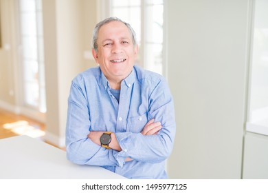 Handsome senior man smiling confident with crossed arms