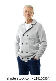 Handsome senior man standing against white background
