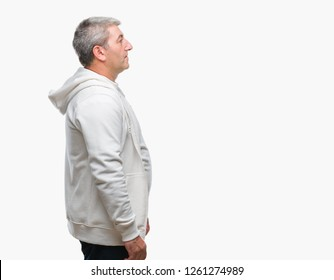 Handsome senior man wearing sport clothes over isolated background looking to side, relax profile pose with natural face with confident smile.