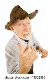 Handsome senior man wearing straw cowboy style hat