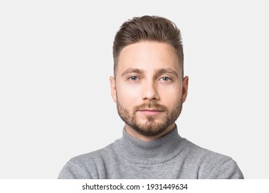 Handsome serious young man portrait. Close-up of male face. Men model with beard and modern haircut. People, lifestyle, male beauty, city life concept