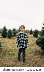 Handsome seven year old boy in a winter or fall lifestyle portrait featuring the young kid in an image from a film scan.