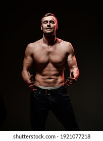 Handsome sexy man with muscular body showing welcome gesture standing isolated on white background. Sport, bodybuilding motivation. Dark studio shot copy space portrait