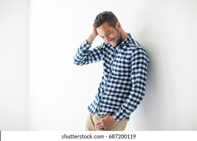 Handsome sexy man touching his hair with copy space