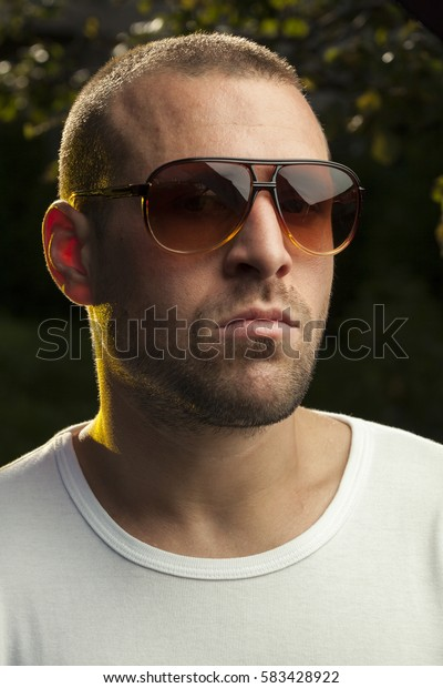Handsome sexy man wearing sunglasses headshot
