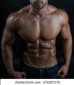 Handsome sexy muscular naked / nude body of a fitness model MMA fighter