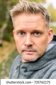 Handsome sexy Scandinavian Caucasian man selfie portrait looking at camera