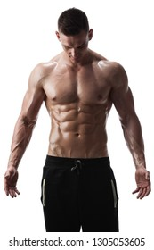 Handsome shirtless athletic man posing on white background