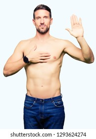 Handsome shirtless man showing nude chest Swearing with hand on chest and open palm, making a loyalty promise oath