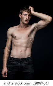 handsome shirtless young man posing in studio