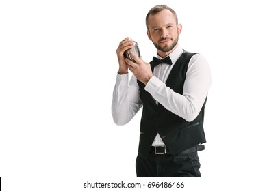 handsome smiling bartender with classical metal shaker isolated on white