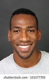 A handsome, smiling black man, headshot.