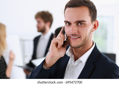 Handsome smiling businessman talk cellphone in office portrait. Stay in touch solution, negotiate meeting job, white collar busy life style, electronic device store, professional training concept