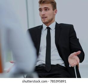 Handsome smiling businessman talking