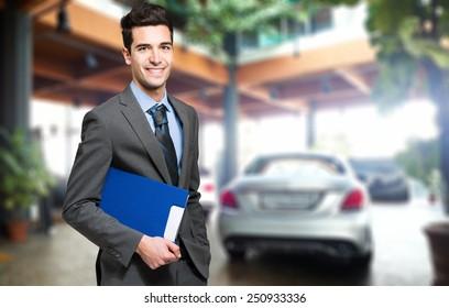 Handsome smiling car dealer portrait