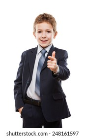 Handsome smiling child boy in business suit index finger pointing direction way or campaign agitating choice white isolated