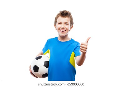 Handsome smiling child boy hand holding soccer ball gesturing thumb up success sign white isolated