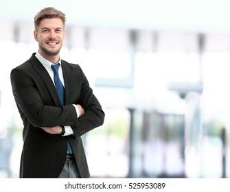 Handsome smiling confident businessman portrait