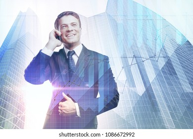 Handsome smiling european businessman talking on the phone on abstract city background with forex chart and copy space. Success, communication and trade concept. Double exposure