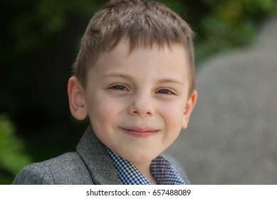 Handsome smiling little caucasian boy