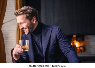 Handsome smiling man with a drink.
