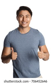 Handsome smiling man in his 20s, standing against a white background wearing a blue tshirt.