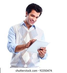 Handsome smiling man with tablet computer. Isolated over white background
