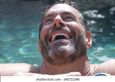 Handsome smiling maturing man in pool / water  - so cute