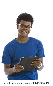 Handsome smiling young African American man holding electronic tablet standing in front of white background