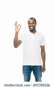 handsome smiling young african american man showing ok sign isolated on white