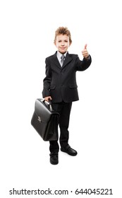 Handsome smiling young businessman child boy hand holding black leather briefcase gesturing thumb up success sign white isolated