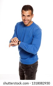 handsome smiling young man in blouse pointing on his wrist watch  on white background