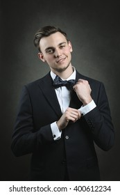 Handsome smiling young man with elegant dress