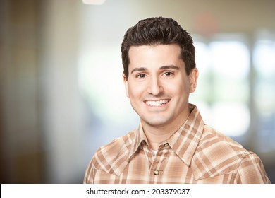 Handsome smiling young man headshot