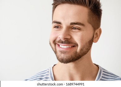 Handsome smiling young man on white background