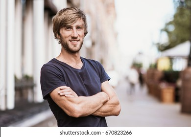 Handsome smiling young man portrait. Cheerful men looking at camera