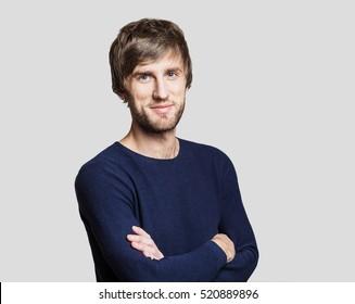 Handsome smiling young man studio portrait