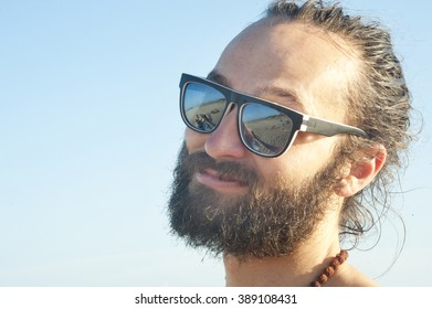 Handsome and Smiling Young Man with Sunglasses
