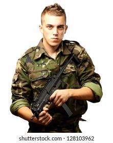 handsome soldier holding gun against a white background