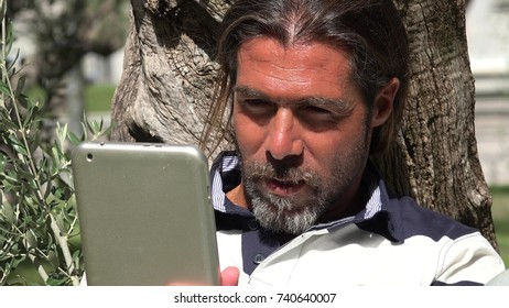 Handsome Spanish Male Using Tablet