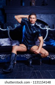 handsome striptease dancer dressed  as priest,  in the interior