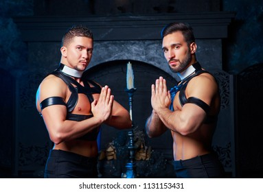 handsome striptease dancers dressed  as priests,  in the interior