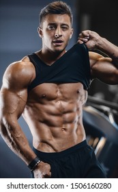 Handsome strong athletic men pumping up muscles workout fitness and bodybuilding concept background - muscular bodybuilder fitness men doing arms abs back exercises in gym naked torso