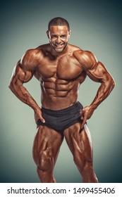 Handsome, Strong BodyBuilder Flexing Muscles