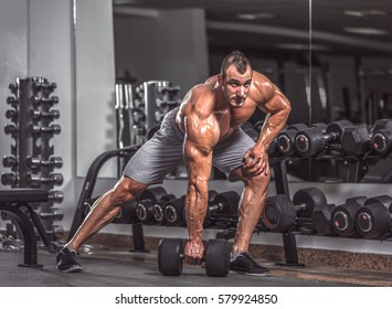Handsome strong man in gym.